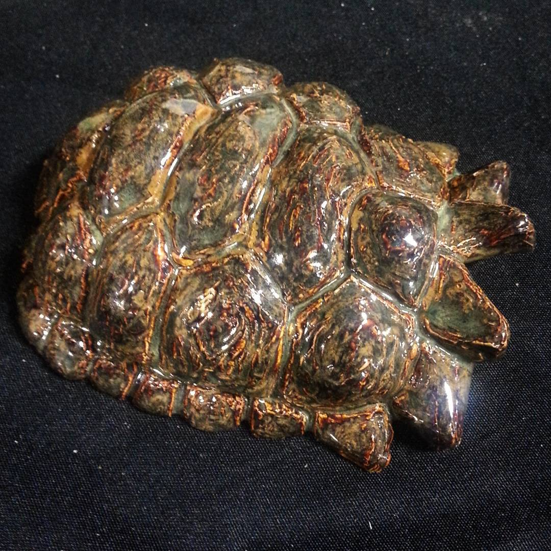 I make a wide array of enclosure furnishings, including hides - like this turtleshell hide - and bowls for your animals. I primarily work in ceramic, epoxy, and natural stone so that everything I make is safe and temperature resistant.